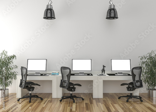 2087fe805 Work desks in empty room with big wall in background | Buy Photos ...