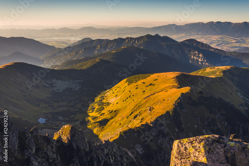 Mountain Landscape at Sunset. View from Mount Dumbier in Low Tatras, Slovakia. West Tatras Mountains and Liptovska Mara Dam in Background.