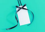 Tag with black ribbon - 124309435