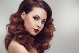 Fashion beauty portrait of a beautiful girl with curly hair luxuriant