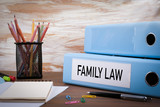 Family Law, Office Binder on Wooden Desk. On the table colored p - 124349442