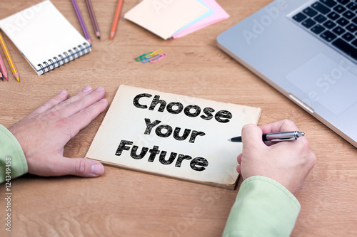 Hand writing Choose Your Future. Office desk with a laptop and s Poster