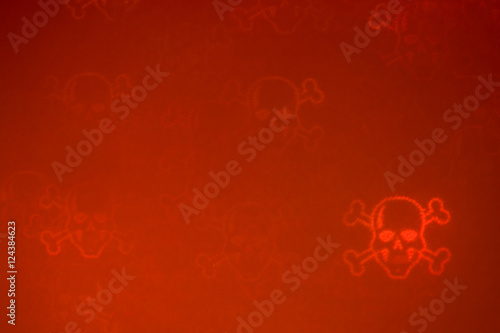 Poster De-focused red bloody luminous grainy skulls & bones in the right down corner on the dark red background