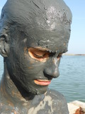 Close-up of a boy after applying a therapeutic mud bath in San Pedro del Pinatar, Spain
