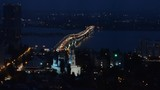 Night view of the city and the bridge. Fast shooting.