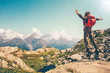 Quadro Happy Man with red backpack jumping hands raised mountains landscape on background Lifestyle Travel active summer vacations outdoor.