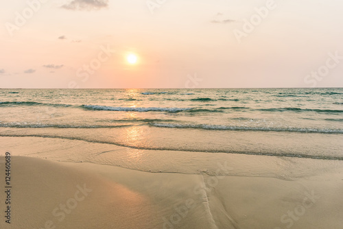 Sunrise and gentle wave at the tropical beach in the moning