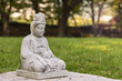 A small stone buddha at a green garden in Korea