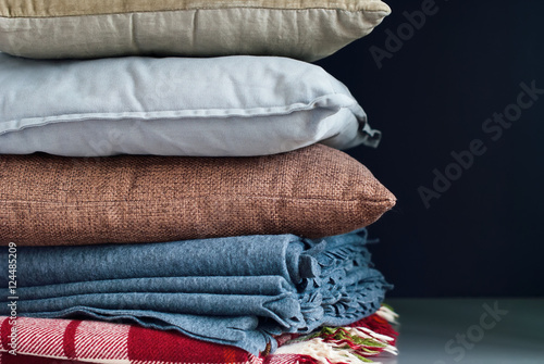 Poster Colorful Pillows Stack on Dark Background