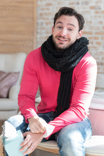 Poster Positive sick man wearing a scarf