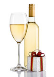 Bottle and glass of white wine and gift box