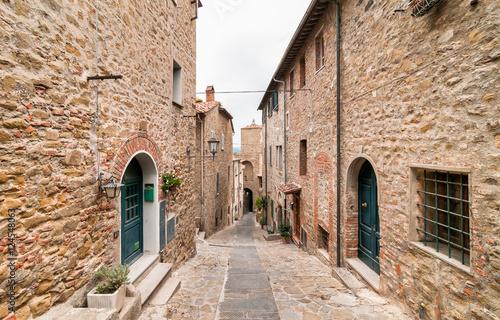 The narrow street in the historic center of Castiglione della Pescaia, Tuscany, Italy
