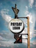 aged and worn vintage photo of payday loan signsign