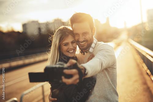 Wall mural Tourist couple taking selfies