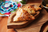 pies samosas with vegetables on a wooden board still life in