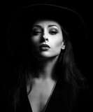 Glamour sexy makeup woman posing in fashion hat on dark backgrou
