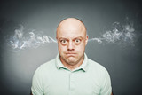 Closeup portrait of angry man, blowing steam coming out of ears, - 124620409