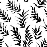 Ink seamless pattern with palm leaves in black and white colors. Artistic background with abstract plants.