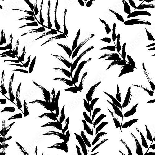Ink seamless pattern with palm leaves in black and white colors. Artistic background with abstract plants.  - 124624852