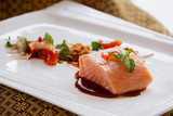 Salmon salad with vegetables and chili sauce tasty