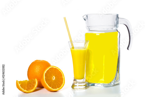decanter and a glass of juice, orange on a white background