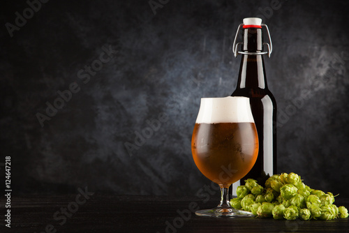 Beer glass on dark background Poster