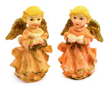 Statuettes of porcelain angels with book and pigeon isolated on white background