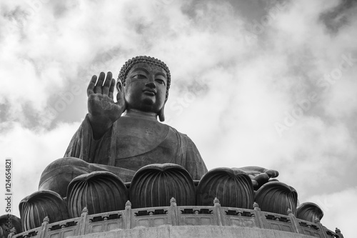 Poster Tian Tan Buddha (Big Buddha) statue in black&white at Ngong Ping on Lantau Island in Hong Kong, China, viewed from below