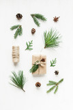 Fototapety Christmas composition with pine cones, fir branches, christmas gift. Top view, flat lay