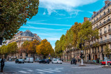 Streets of Paris, France. Blue sky, buildings and traffic. Shot in late autumn daylight.
