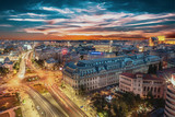 Fototapety Aerial view of capital city Bucharest, Romania. University Square at sunset with traffic lights.