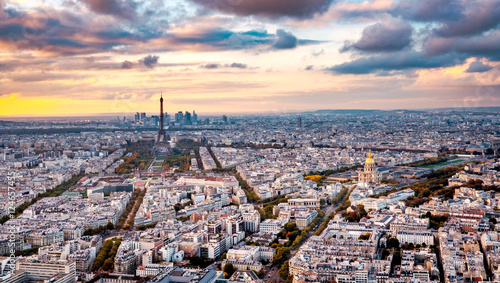 Aerial Paris view in late autumn from Montparnasse Tower at sunset. Eiffel Tower in the distance and financial district. © Augustin Lazaroiu