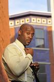 Handsome African American Businessman Adjusting his Tie