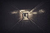 Empty underpass tunnel at night, desaturated colors