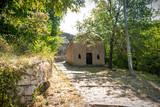 Fototapety Casetta sperduta nel bosco