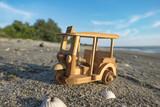 travel image concept, wooden miniature tuk-tuk, most iconic Thailand transport