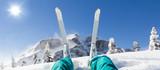 Detail of alpine skier legs, watching the valley panorama - 124746413