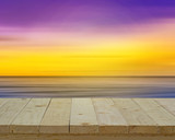 wood top on abstract motion blur sea in colorful filter and vint