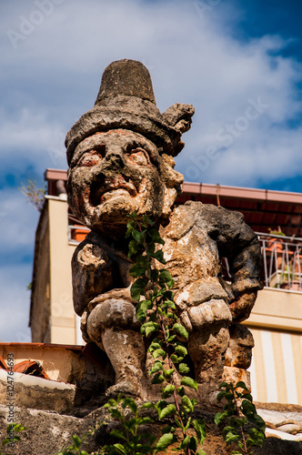 Poster Palermo This is famous grotesque statues with human faces that decorate garden and wall of Villa Palagonia