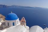 Anastasis church in Oia in front of caldera of Santorini, Greece - 124770056
