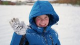 child standing and sweet smiling in winter time.