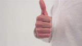 Thumbs up close-up on a white background