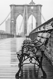 Brooklyn Bridge with no people on a rainy day with a bench in the foreground - 124805065