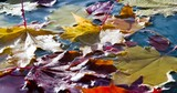 Yellow Leaves Falling in Autumn Puddle