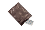 Blue pills in package in brown plastic bag protecting pill from light