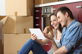 Couple moving home and buying online