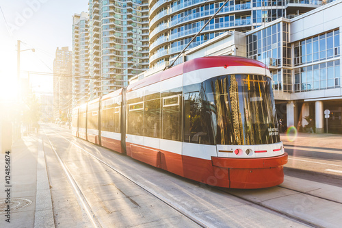 Modern tram in Toronto downtown at sunset Plakat