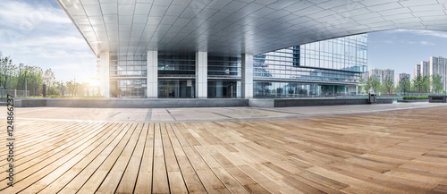 mata magnetyczna office building entrance with wooden floor foreground,china.