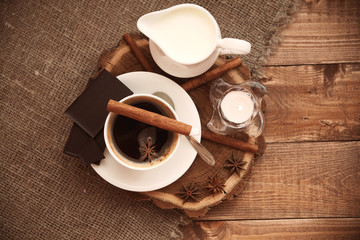 cup of hot coffee on a wooden tray