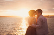 Romantic and stylish caucasian couple hugging at sunrise. Love, relationships, romance, happiness concept.